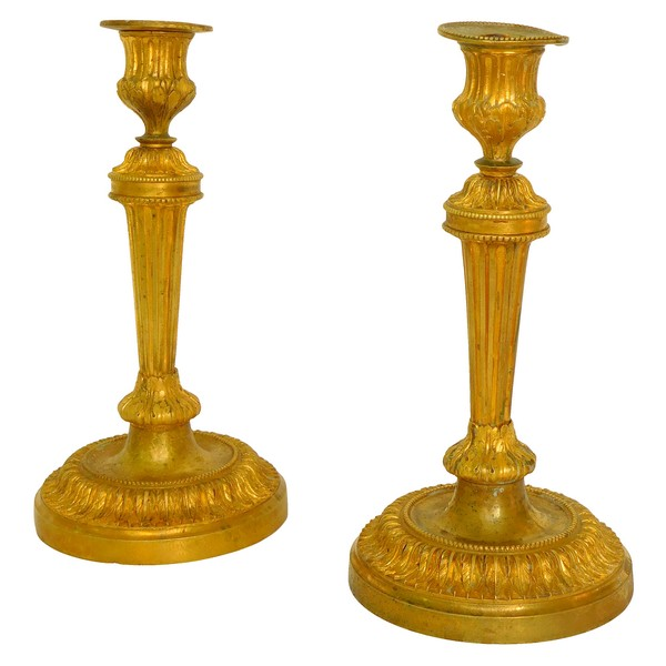 Pair of Louis XVI style ormolu candlesticks after a design by Feuchere, late 19th century