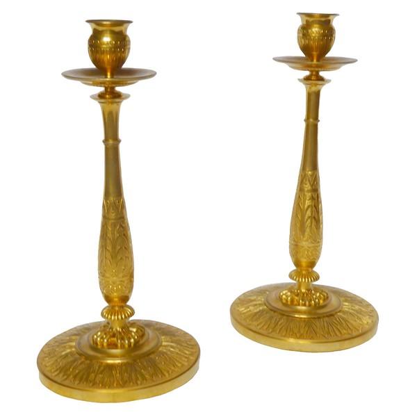 Claude Galle : paire de bougeoirs Empire en bronze doré au mercure