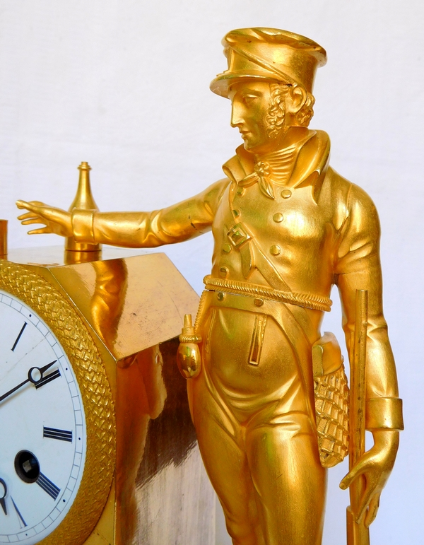 Empire ormolu clock picturing a hunter, early 19th century