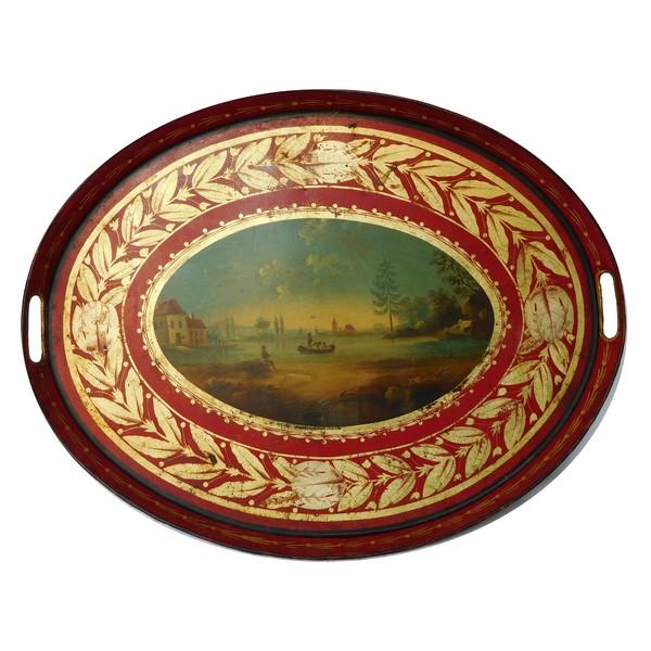 Plateau en tôle peinte dorée rouge à décor de paysage, époque Empire Restauration