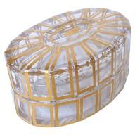 Boîte à poudre / bonbonnière ovale en cristal de Baccarat, modèle Cannelures réhaussé de filets or