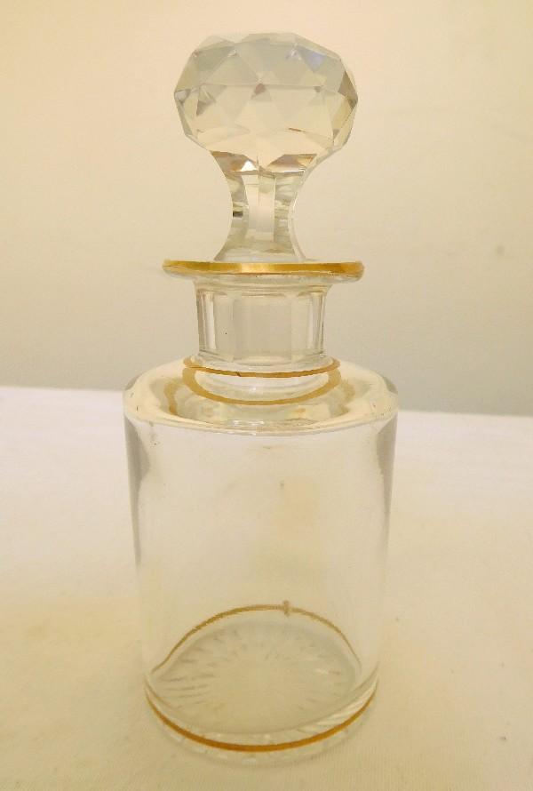 Flacon à parfum en cristal de Baccarat, cristal uni à fond étoile rehaussé de filets et étoiles dorés - 14cm
