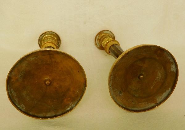 Paire de flambeaux Empire en bronze patiné et doré attribués à Ravrio, époque début XIXe