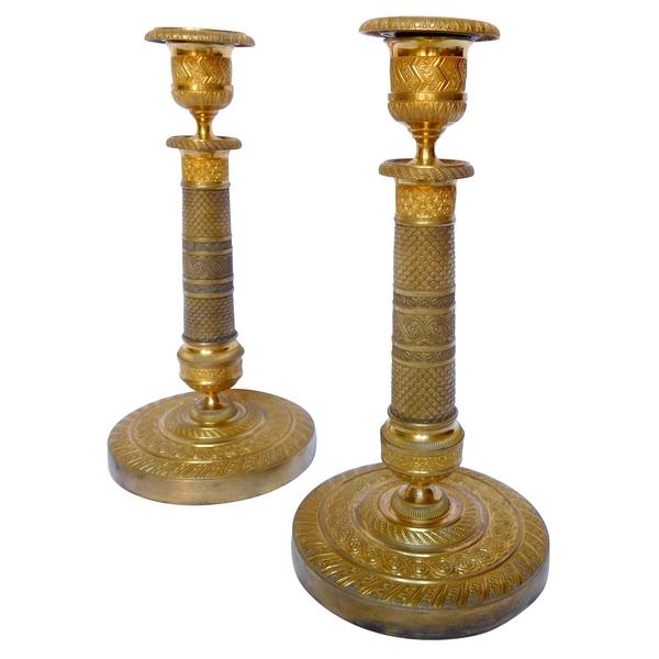 Paire de bougeoirs d'époque Empire, bronze doré au mercure, époque début XIXe