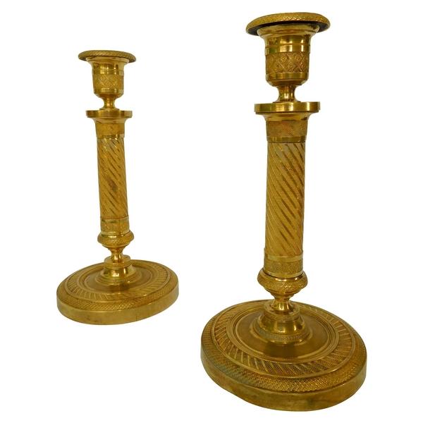 Paire de bougeoirs en bronze doré au mercure d'époque Empire