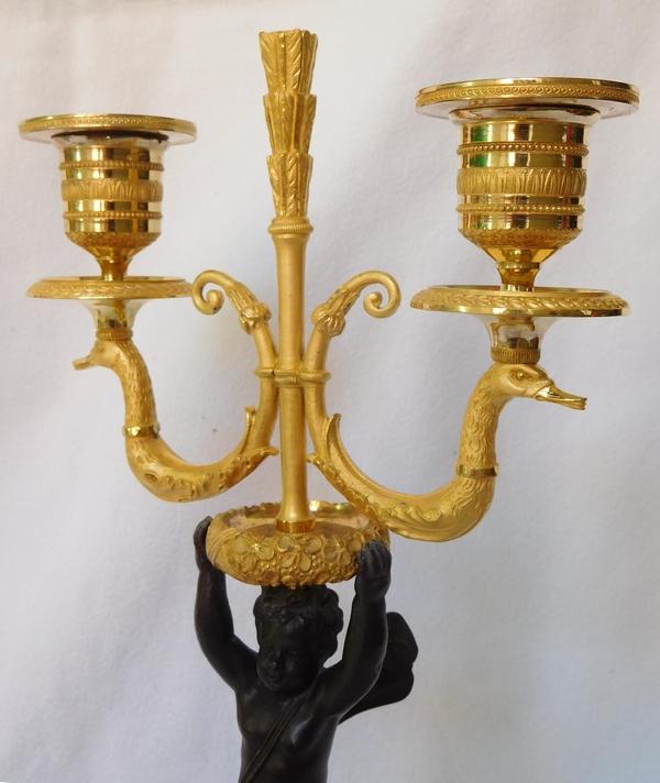 Paire de candélabres en bronze patiné et doré d'époque Empire / Restauration