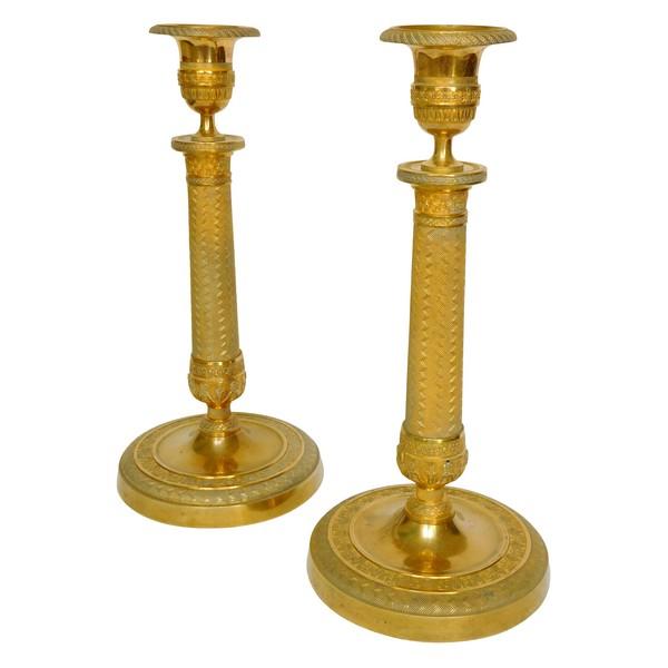 Paire de bougeoirs / flambeaux en bronze doré au mercure d'époque Empire - Restauration - 26,5cm