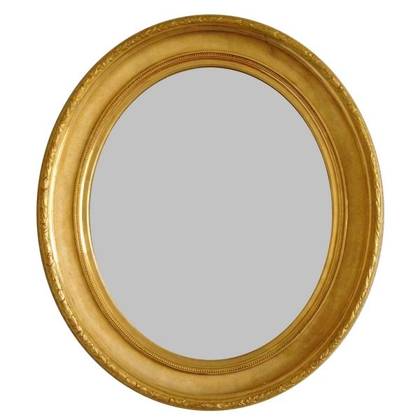 Grand miroir ovale XIXe en bois doré à la feuille d'or, glace au mercure, 82cm x 71cm