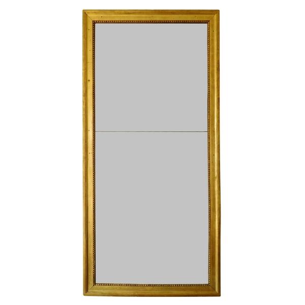 Miroir d'entre deux ou trumeau d'époque Louis XVI, bois doré à la feuille d'or, glace au mercure