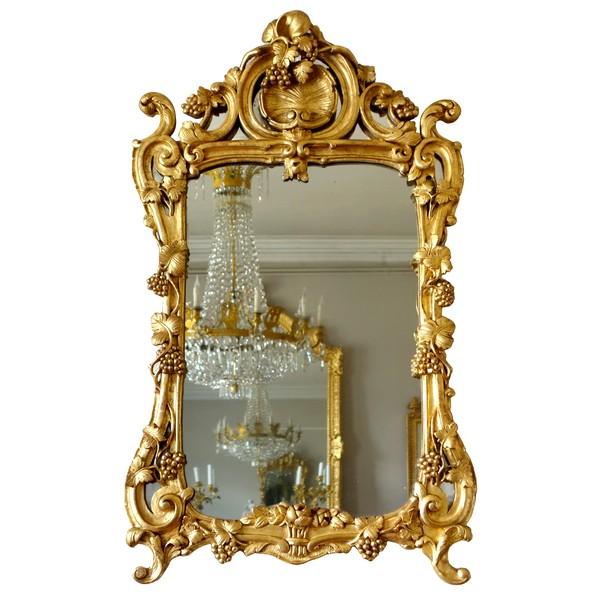 Miroir d'entre-deux en bois doré, glace au mercure, travail Provencal d'époque Louis XV Transition
