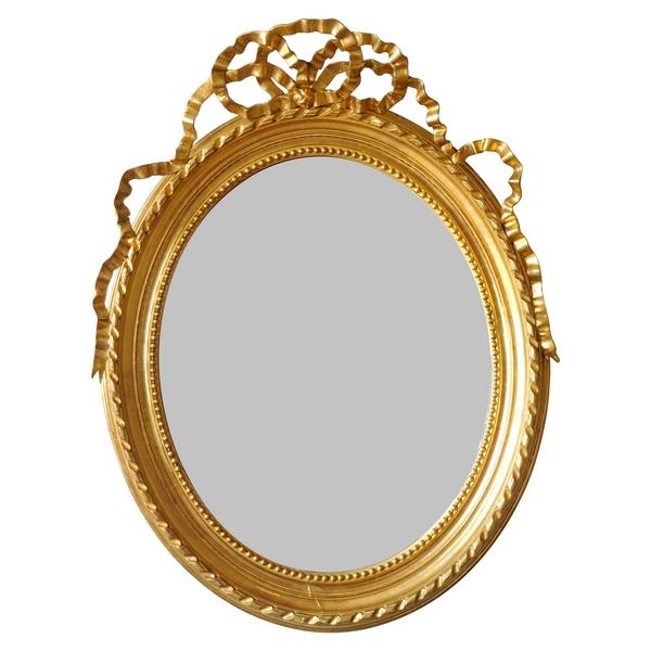 Miroir ovale de style Louis XVI en bois doré, glace au mercure - 86cm x 112cm