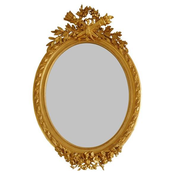 Grand miroir ovale de style Louis XVI en bois doré à la feuille d'or époque Napoleon III - 119cm x 79cm