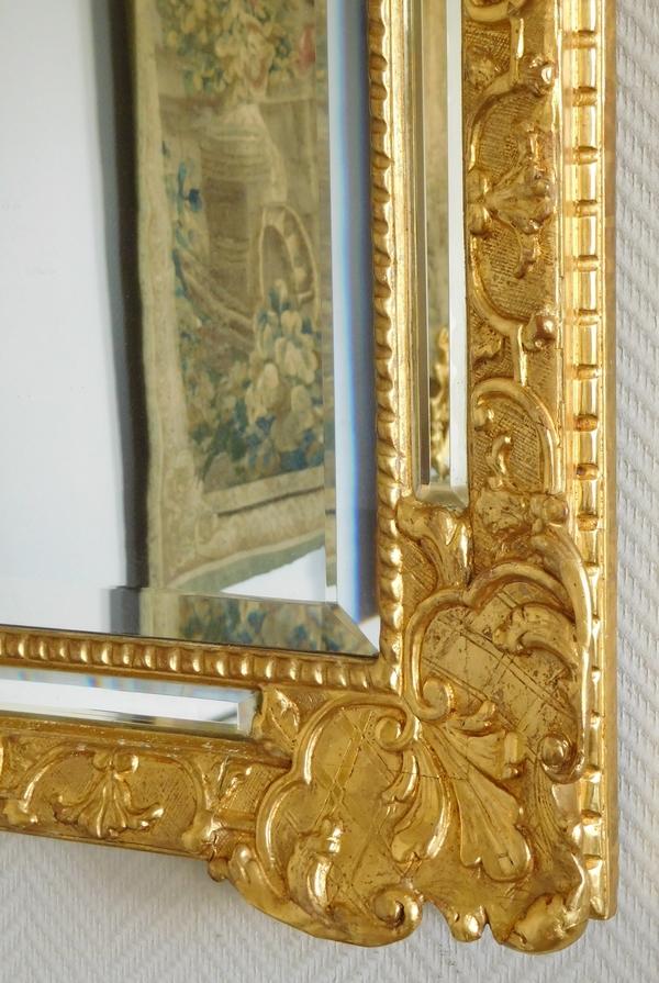 Miroir à pare-closes en bois doré d'époque Louis XIV, glace au mercure