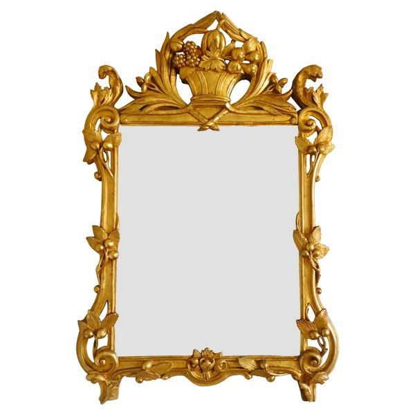 Miroir en bois doré, glace au mercure, travail provençal d'époque Louis XV