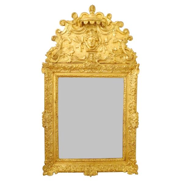 Miroir à fronton en bois doré d'époque Régence, masque d'Indienne, glace au mercure XVIIIe