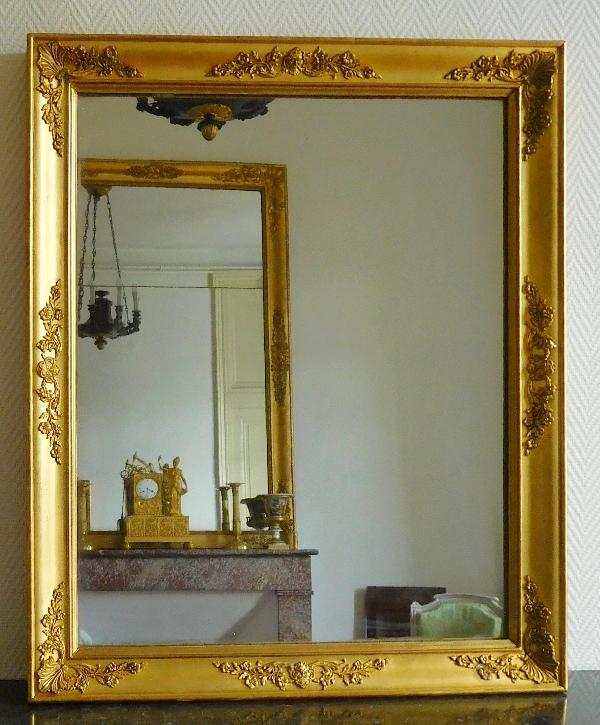 Miroir empire aux mascarons glace au mercure cadre en for Miroir au mercure