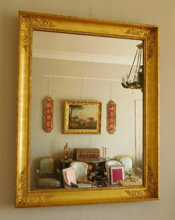 Miroir aux cygnes d'époque Empire Restauration en bois doré - 105cm x 84cm