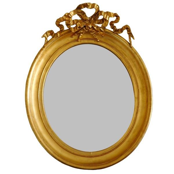 Grand miroir ovale de style Louis XVI en bois doré, glace au mercure - 71cm x 91cm