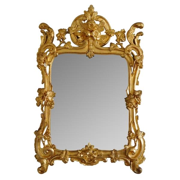 Miroir en bois doré, glace au mercure, travail Provencal d'époque Louis XV - Transition