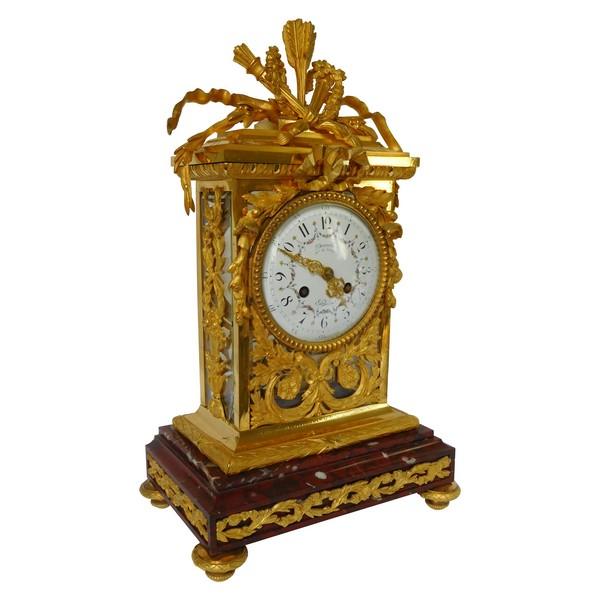 Pendule cage de style Louis XVI en bronze ciselé et doré et marbre griotte, époque XIXe