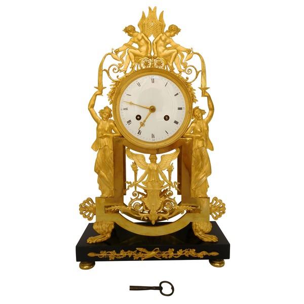 Grande pendule d'époque Empire en bronze doré au mercure - La Fontaine de Jouvence