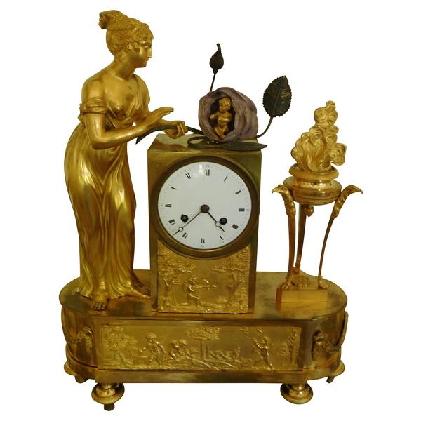 Pendule Empire en bronze doré, allégorie de la naissance du Roi de Rome
