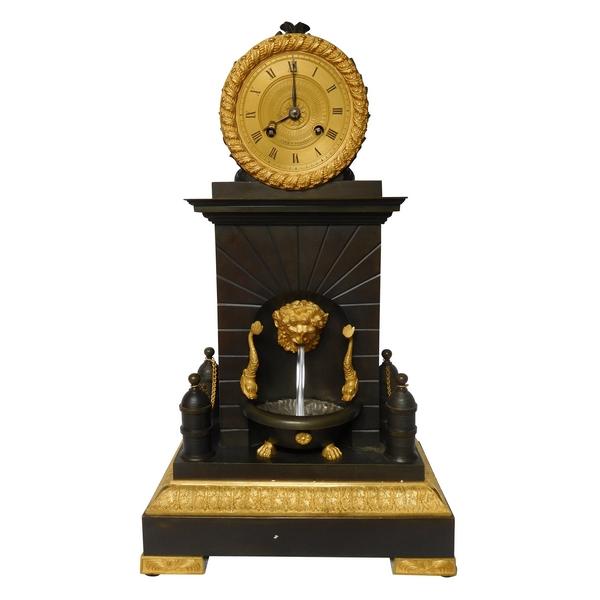 Pendule fontaine mécanique en bronze patiné et doré au mercure d'époque Restauration