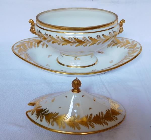 Locré : saucière en porcelaine d'époque Empire rehaussée à l'or fin