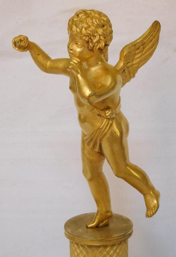Amour en bronze doré au mercure, socle marbre brèche d'Alep, époque Restauration