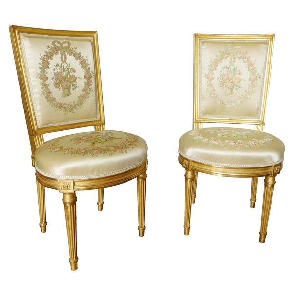 Paire de chaises en bois doré à la feuille d'or de style Louis XVI