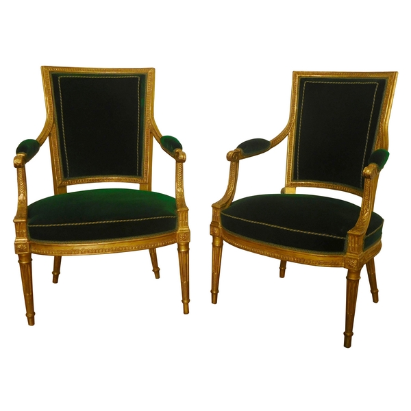 Paire de fauteuils cabriolets en bois doré estampillés JB Boulard, époque Louis XVI