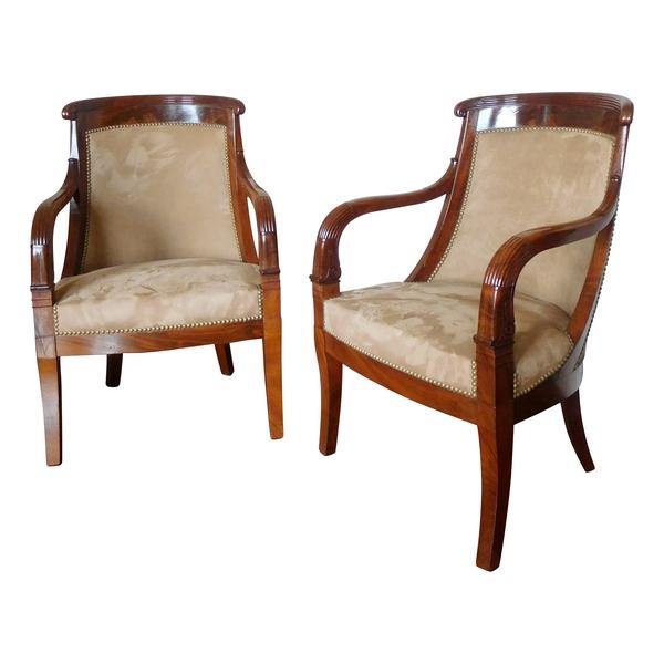 Paire de fauteuils gondole en acajou sculpté d'époque Empire Restauration
